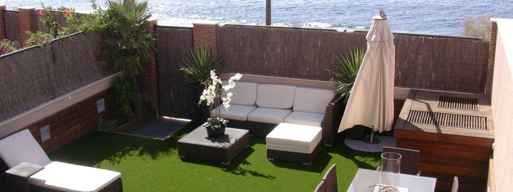viste tu terraza o jardin con cesped artificial